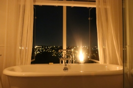 Bath - candle lit relaxation with views out to the sky tower